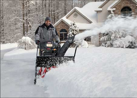 image of main using snowblower